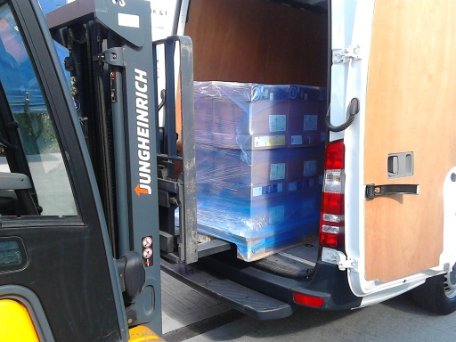 Loading pallets into MSP Logistics van with forklift